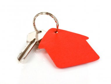 Key with house-shaped charm isolated on white