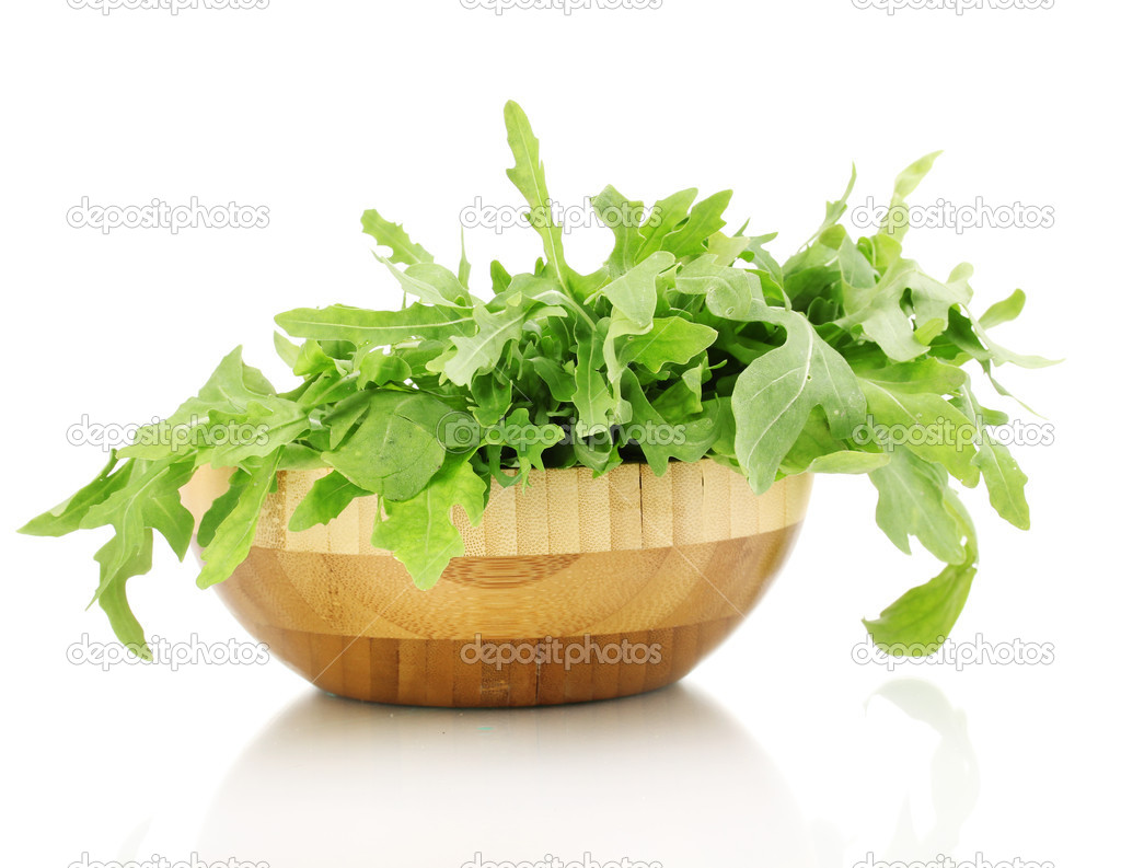 Fresh Rucola Salad Or Rocket Lettuce Leaves In Wooden Bowl Isolated On White Stock Photo