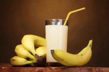 Banana juice with bananas on brown