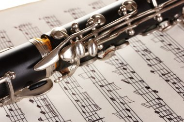 Close up detail of clarinet and notebook with notes