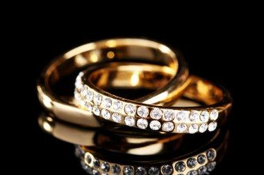 Golden ring on black