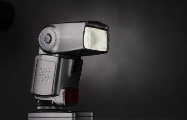 Photo camera flash on black background