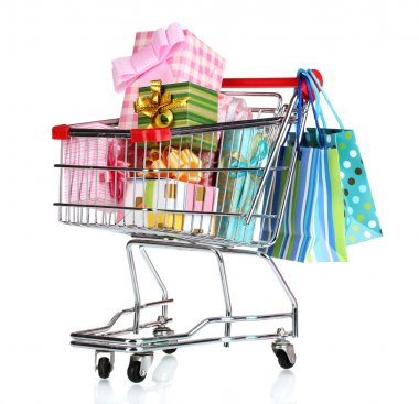 Shopping cart with bright gifts and paper bags isolated on white