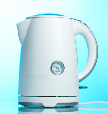 White electric kettle on blue