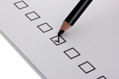 Checklist and black pencil closeup