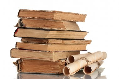 Pile of old books and scroll isolated on white
