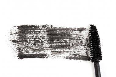 Black mascara brush stroke close-up isolated on white