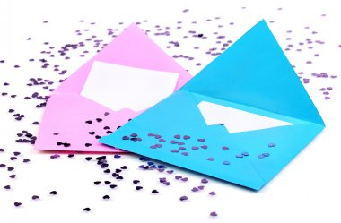 Color envelopes and confetti isolated on white