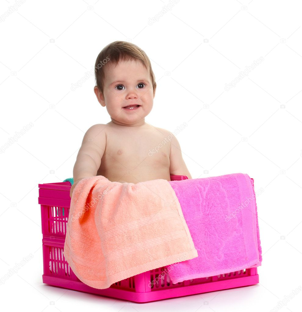 767c2f638 Cute baby girl sitting in laundry basket isolated on white — Stock ...