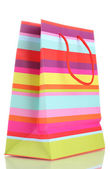 Striped gift bag isolated on white