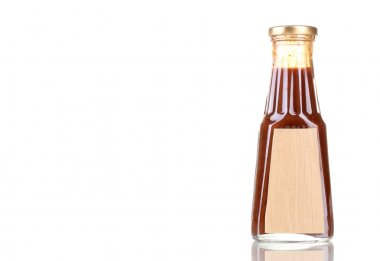 Tomato sauce in glass bottle isolated on white