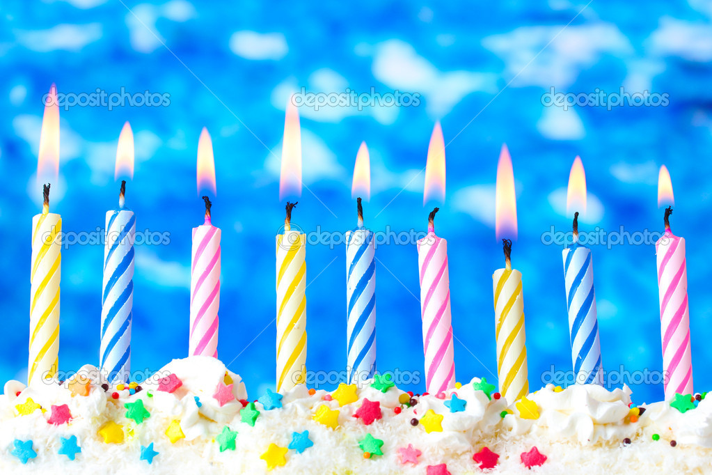 Beautiful Birthday Candles On Blue Background Stock