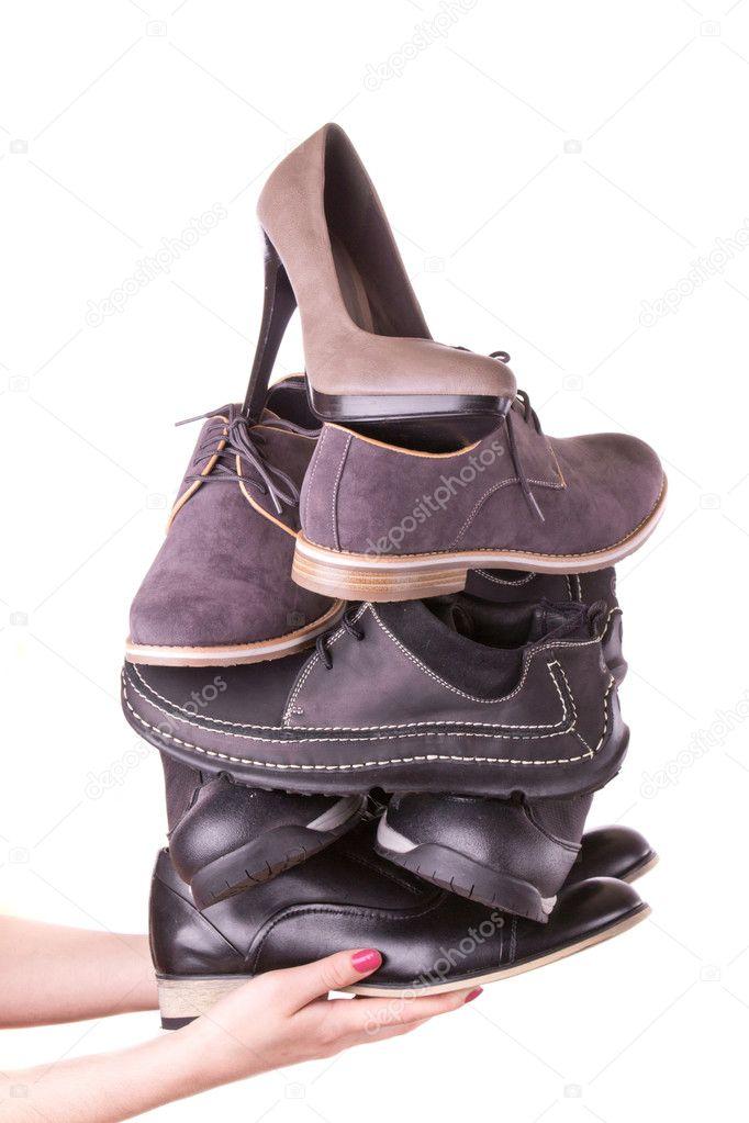 573a342626bf54 viele Herrenschuhe und eine Frau Schuh — Stockfoto © a2bb5s  10554199