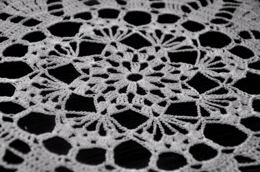 White Crochet Lace on Black Background
