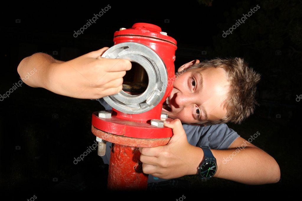Boy posing with fire hydrants