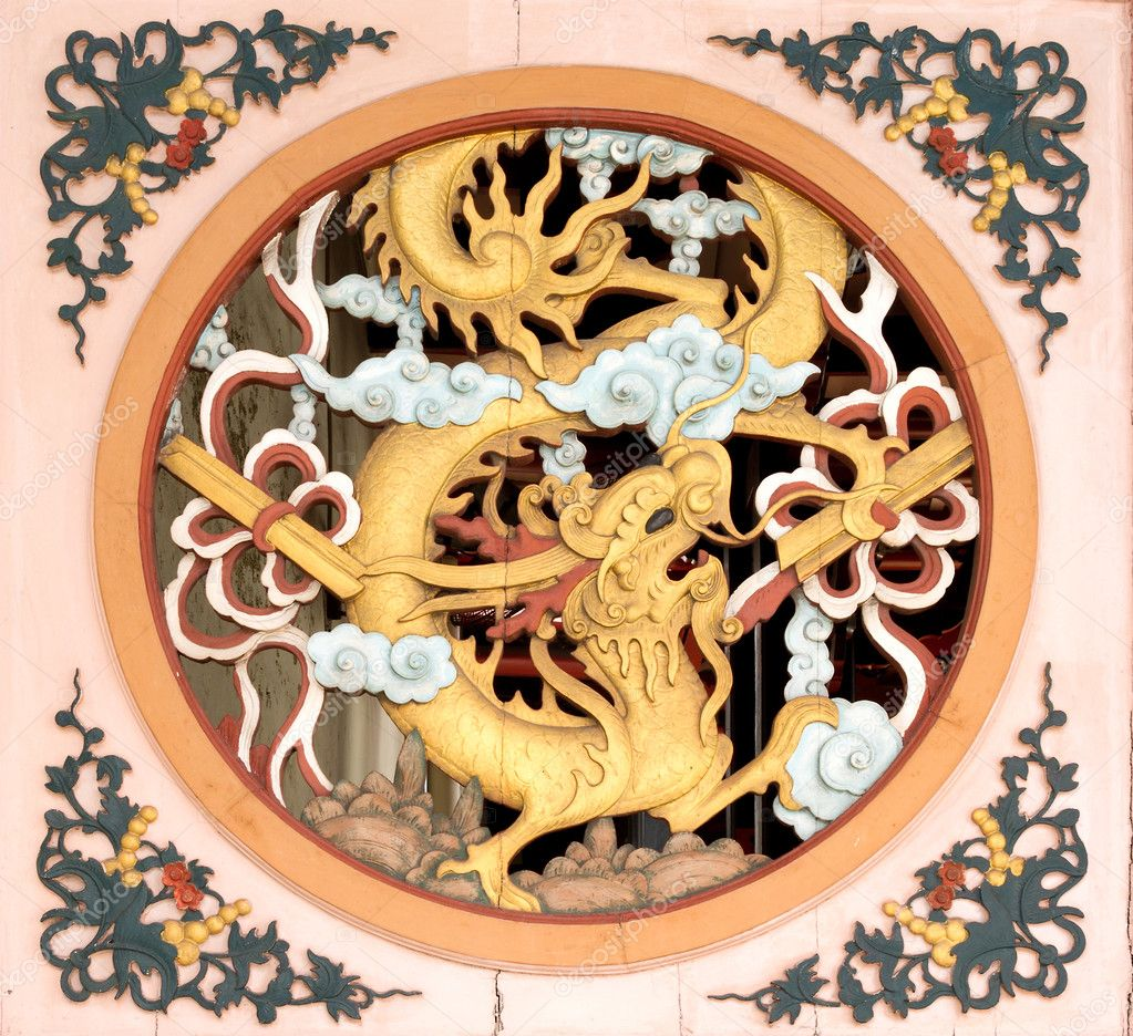 chinese dragon emblem on entrance of old temple u2014 stock photo