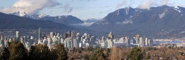 Vancouver BC City Skyline and Mountains