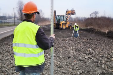 Building a road - Surveyors at work