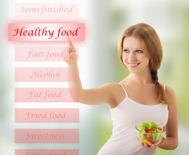 Beautiful girl with vegetable salad choose healthy food