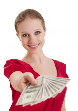 Beautiful cheerful girl in a red blouse holds out a wad of money