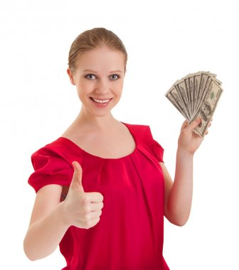 Beautiful successful young woman in a red blouse shows a thumb