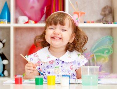 Little girl paints paints stock vector