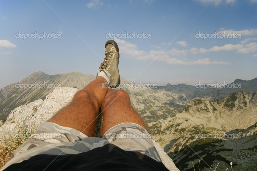 Male Legs Relaxing at the Summit