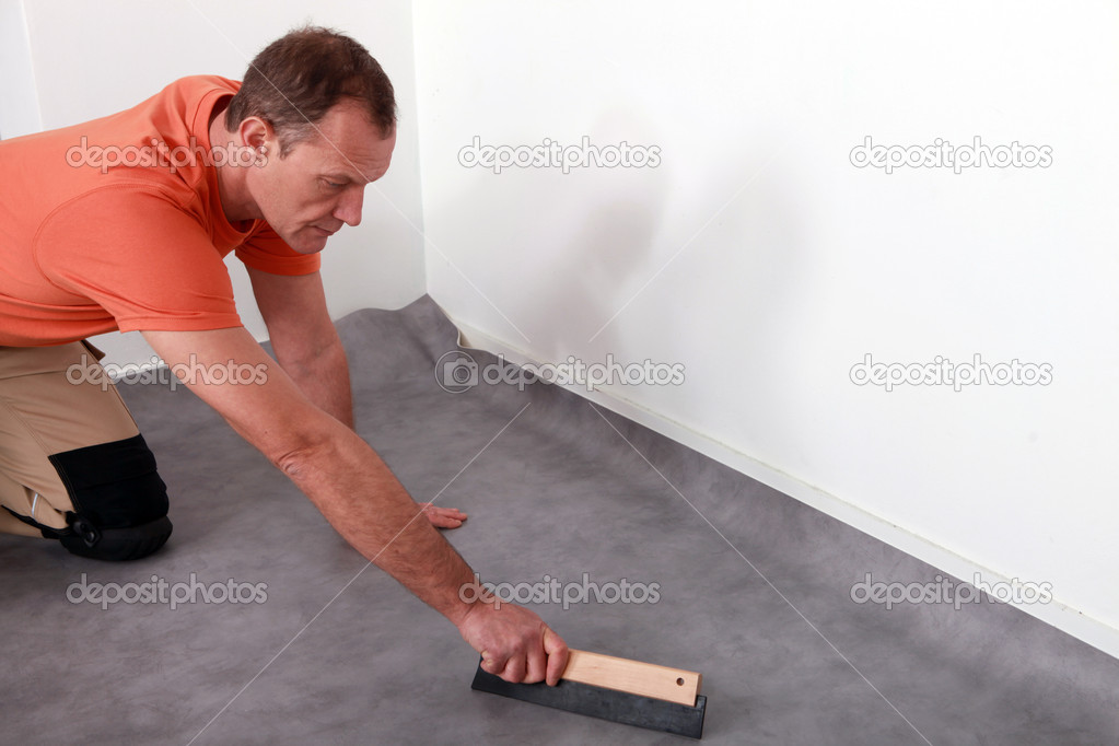 Man Fitting A Lino Floor Stock Photo 169 Photography33