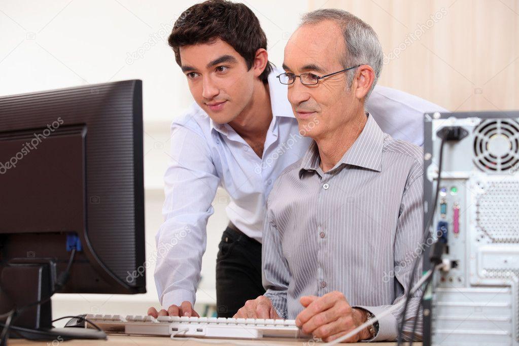 computer technician helping office worker  u2014 stock photo