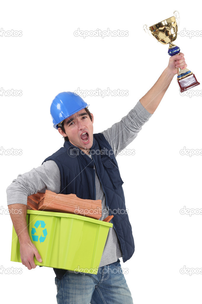 Builder with a trophy recycling material — Stock Photo