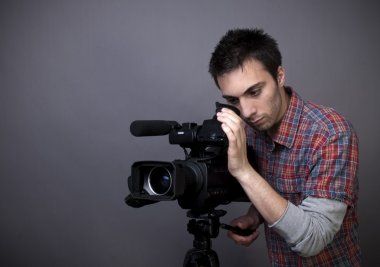 Young man with video camcorder