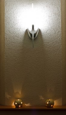 Lighted wall lamp (sconce) and candles
