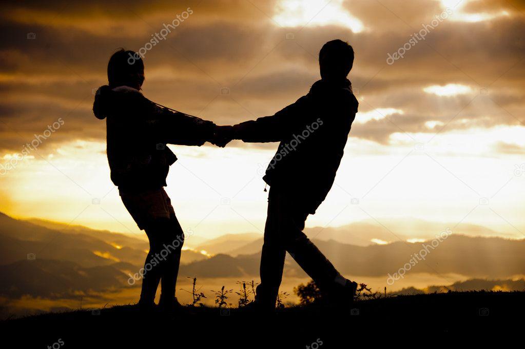 Silhouette of Pre-wedding couple on light