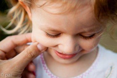 Child cheek pinch