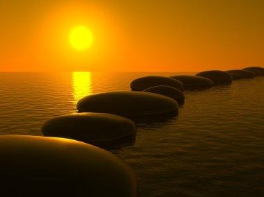 Zen stones in water, sunset