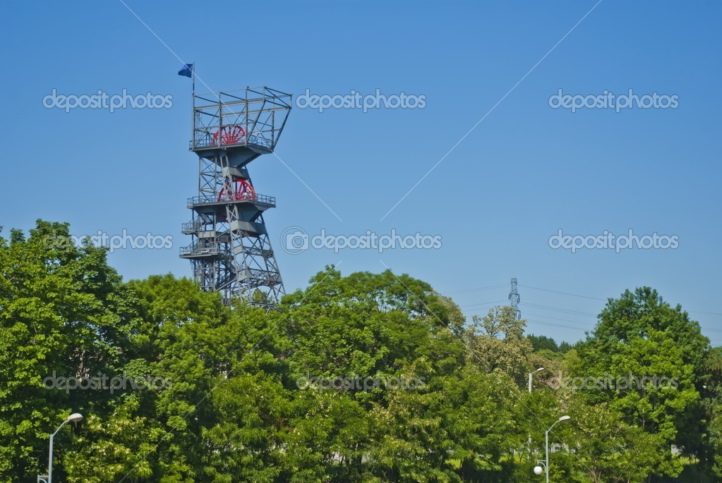 Coal Mine Shaft Tower, Nature and Industry with Trees and Blue Sky