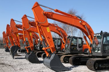 New, shiny and modern orange excavator machines. Construction industry machinery. stock vector