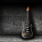 Fotografie Electric guitar and the wall