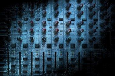 Audio mixing console closeup - music concept, studio shot