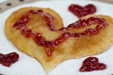 Flat cake heart with strawberry jam
