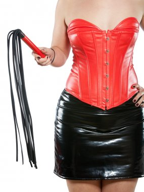 Woman in red leather corset with whip