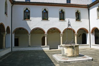 Cloister of the convent with the ancient well