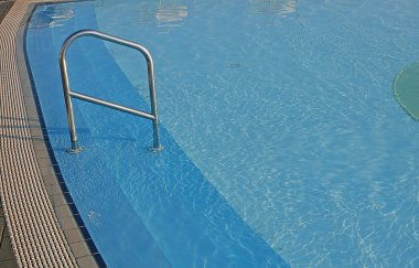 Blue water of the swimming pool for swimming