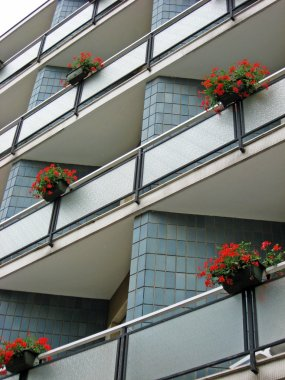 Flowered balconies with pots of geraniums
