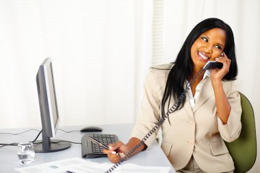 Happy executive talking on phone