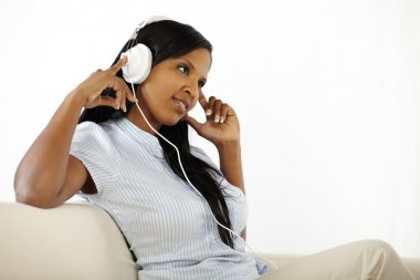 Young woman listening to music and resting