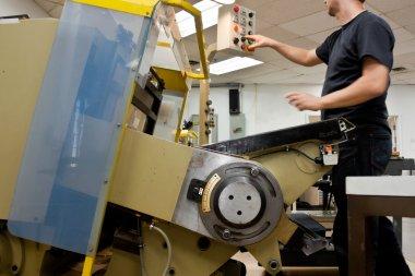 Die cut: machine and press-ion operator