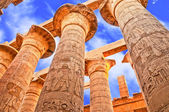Photo Great Hypostyle Hall and clouds at the Temples of Karnak (ancient Thebes). Luxor, Egypt