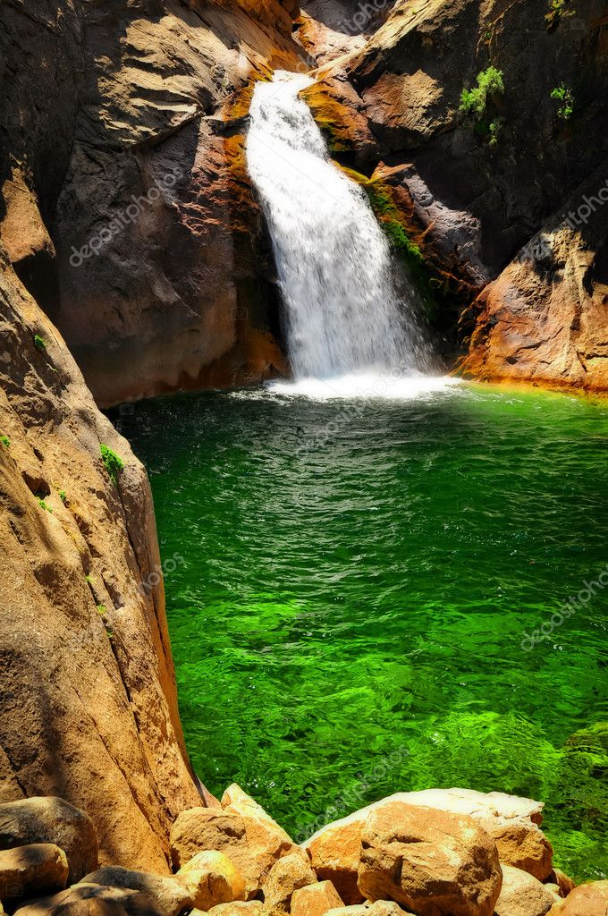 Waterfall with green water in King's Canyon