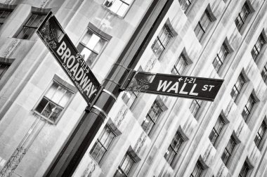 Wall street and Broadway street sign black and white, New York